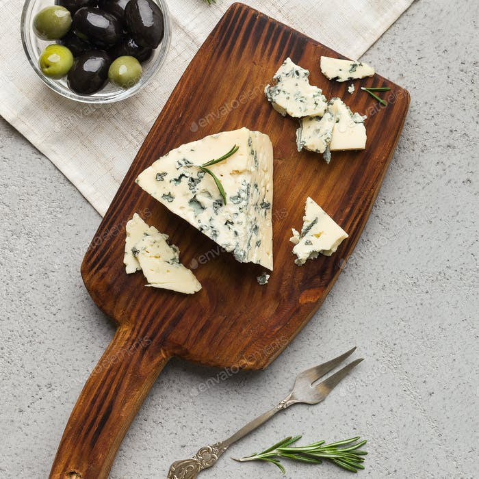 Blue cheese served on wooden board