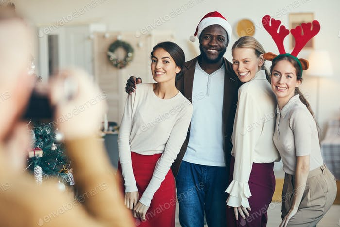 Group of Friends Taking Pictures at Christmas Party