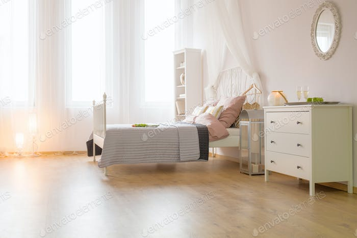 Spacious bedroom with bed