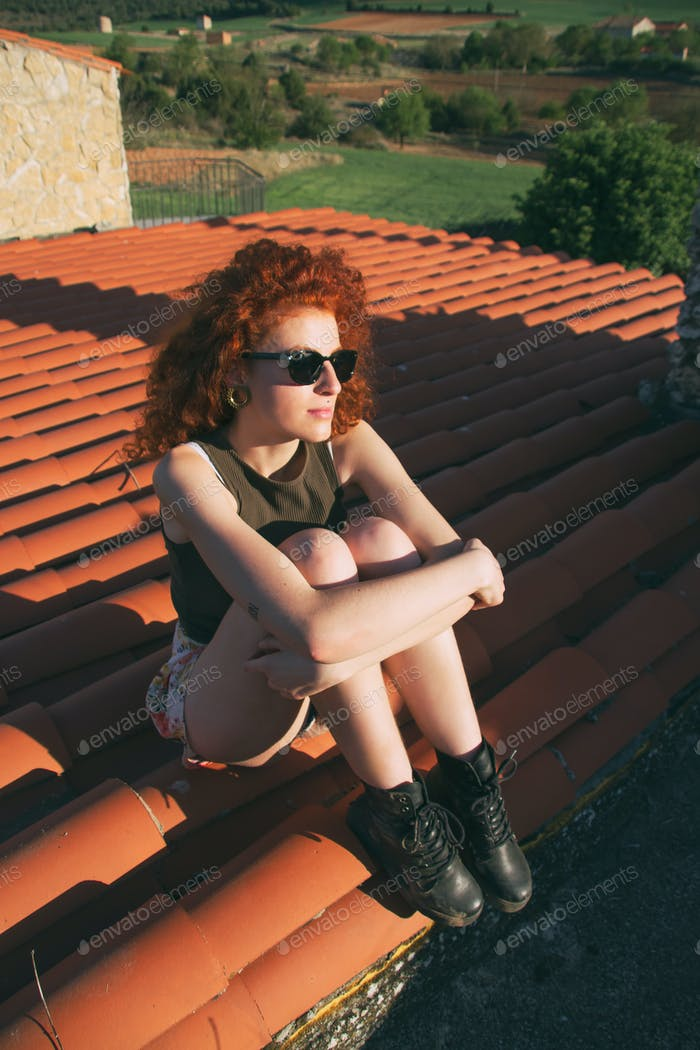 Young redhead woman enjoying a sunny day