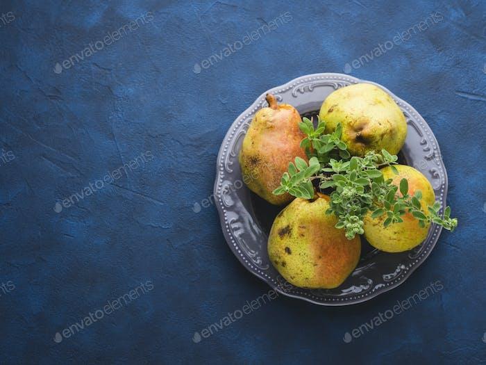 Pears on dark blue background