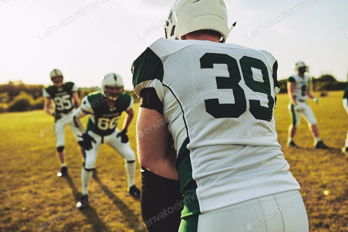 American football team doing tackle drills during practice