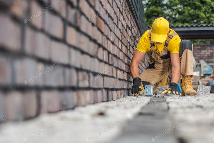 Granite Brick Paving Worker