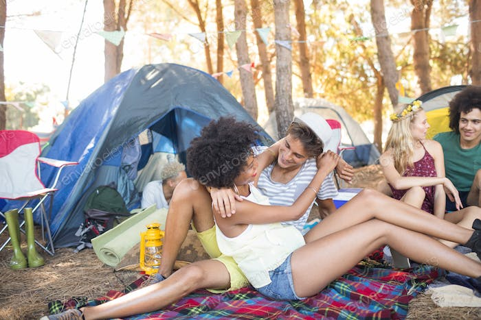 Affectionate couple camping at campsite