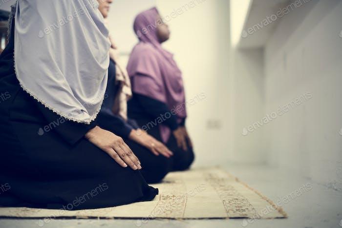 Muslim people praying