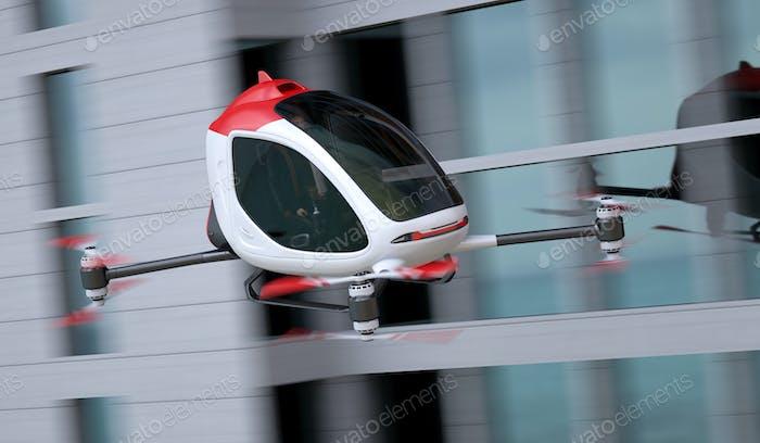 Elektrische PassagierDrohne fliegt vor Gebäuden