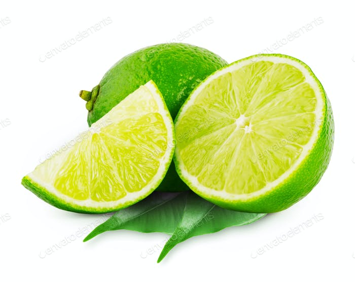 Whole and slices of lime with leaves
