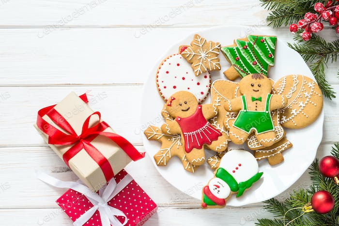 Christmas gingerbread in the plate on white. Top view
