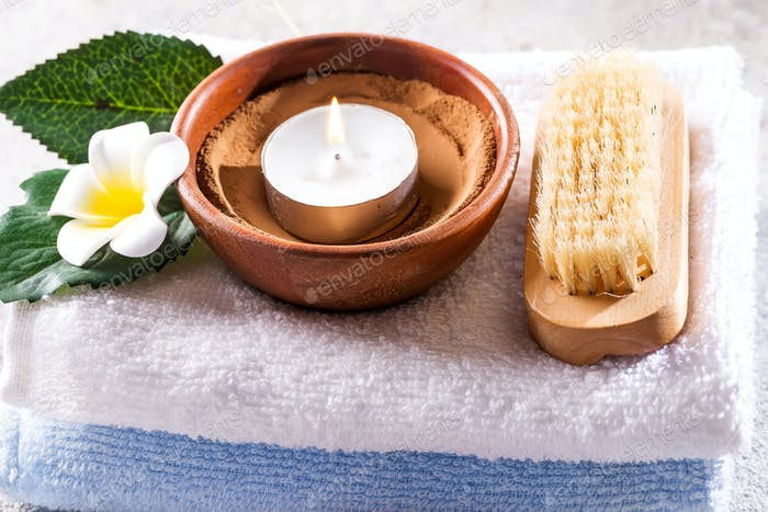 Beauty and spa concept with spa set on rustic stone background