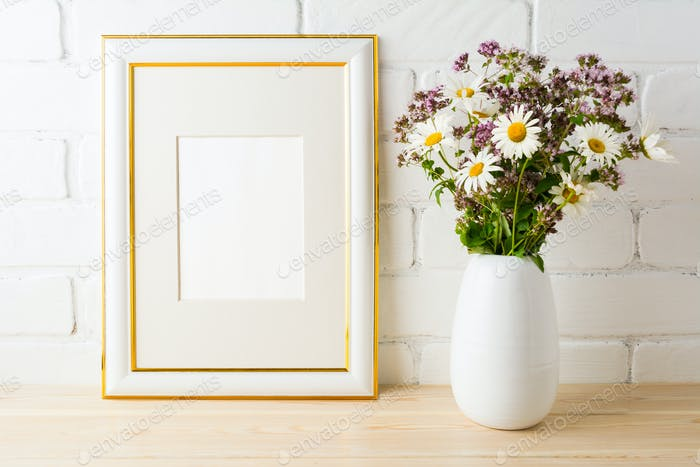 Frame mockup with wild flowers bouquet