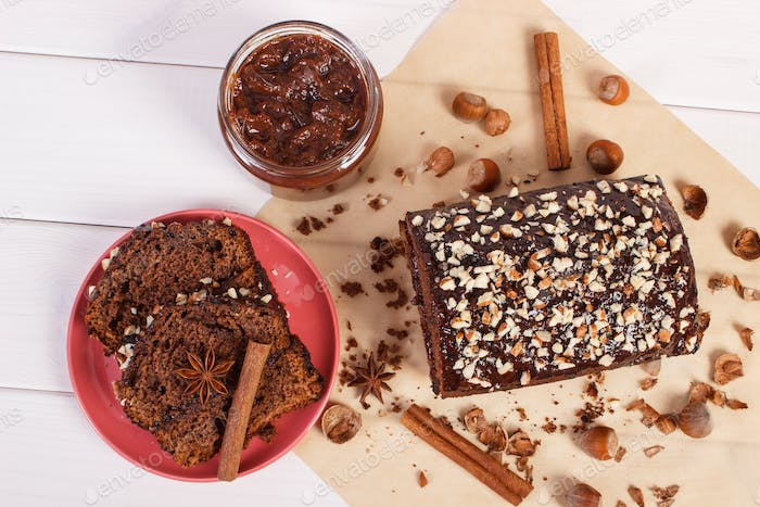 Gingerbread or dark cake with chocolate, cocoa and plum jam, concept of delicious dessert