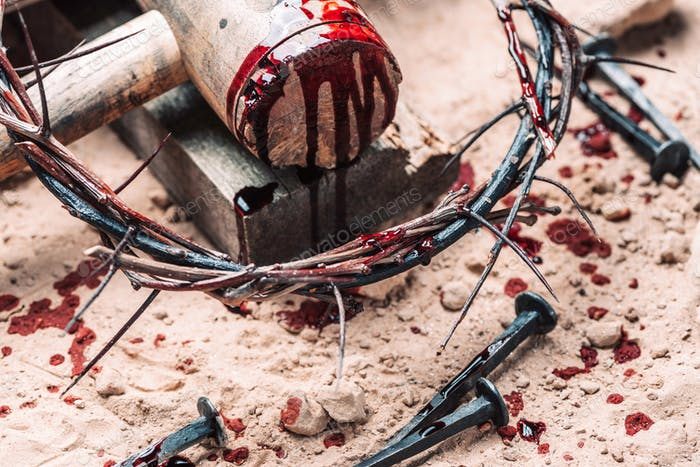 Bloody nails, crown of thorns with drops of blood over grunged background. Good Friday, Passion of