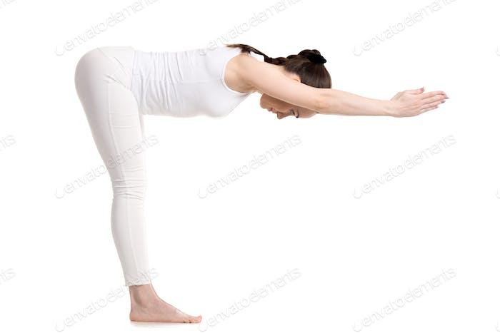 Yogi female standing in Ardha Uttanasana pose