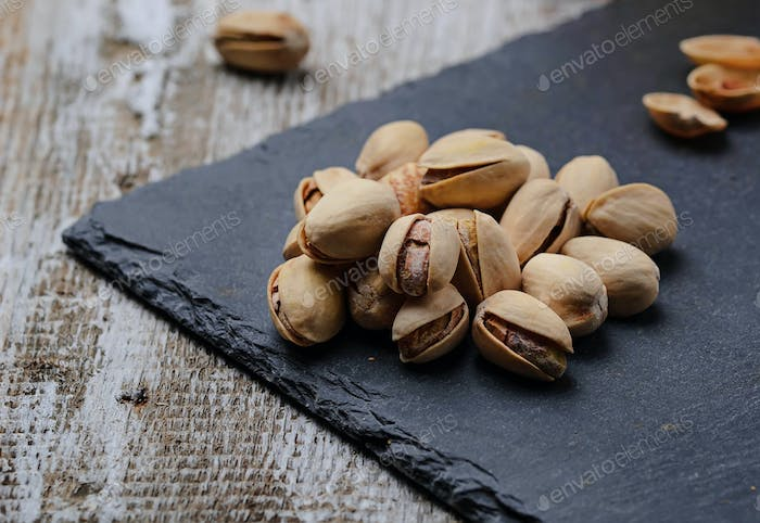 Pistachio nuts on slate board