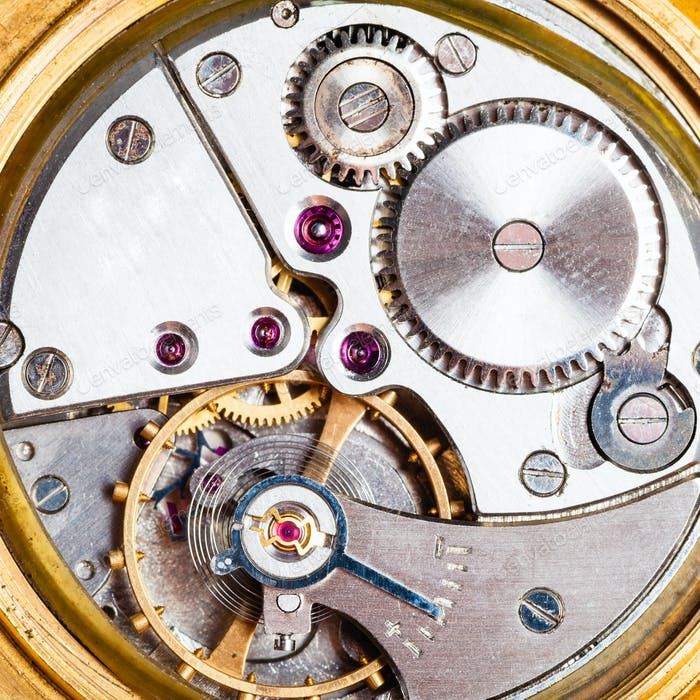 clockwork of old mechanical golden watch