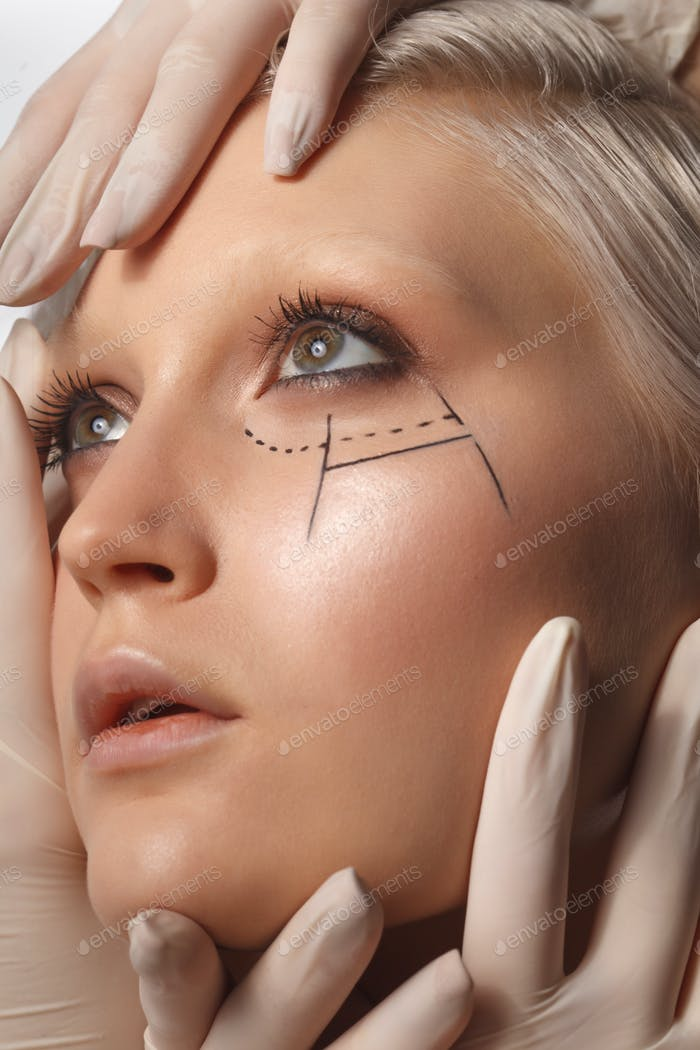 many hands wearing latex medical gloves holding beauty woman face