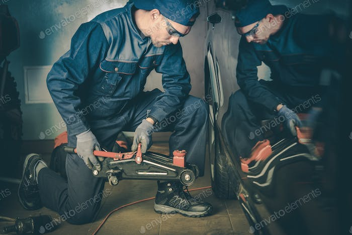 Car Mechanic in Garage