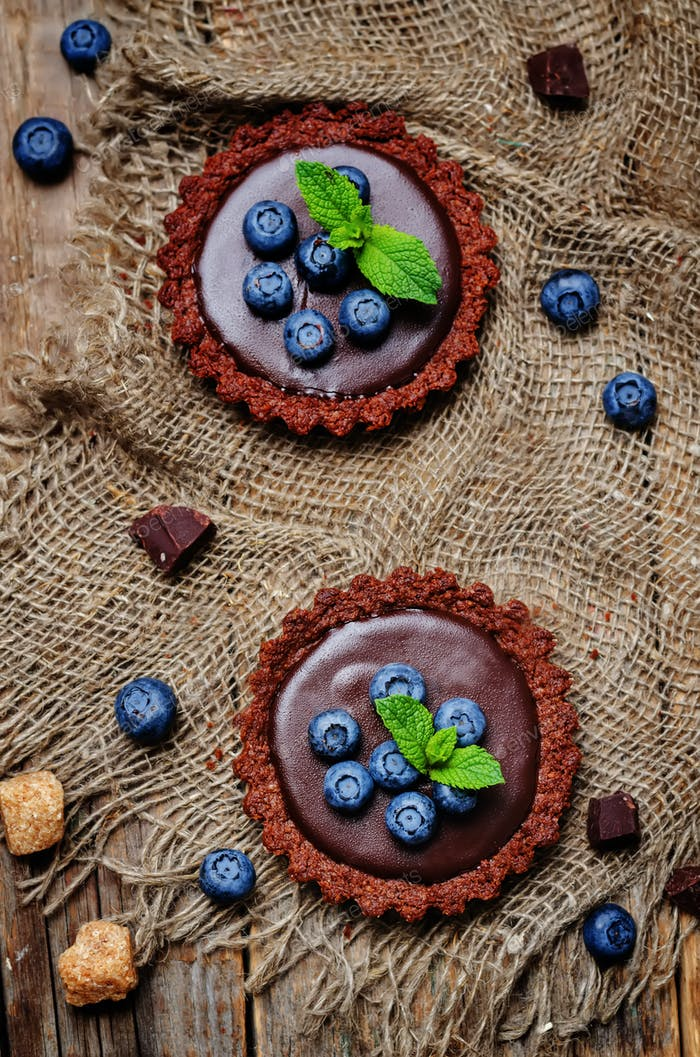 chocolate tartlets with chocolate filling and fresh blueberries