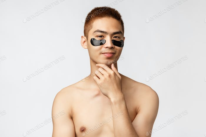 Beauty, people and lifestyle concept. Thoughtful enthusiastic, handsome naked asian man wearing eye