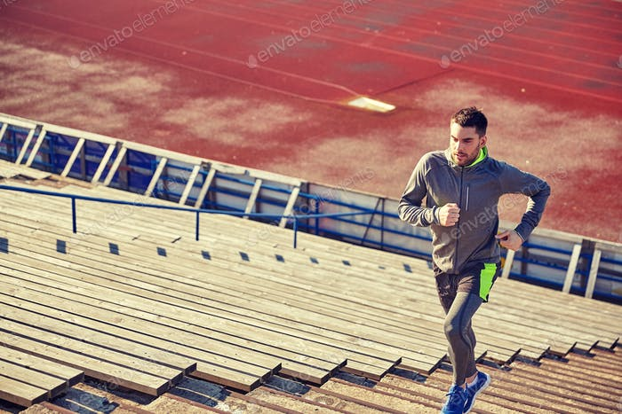 young man running upstairs on stadium