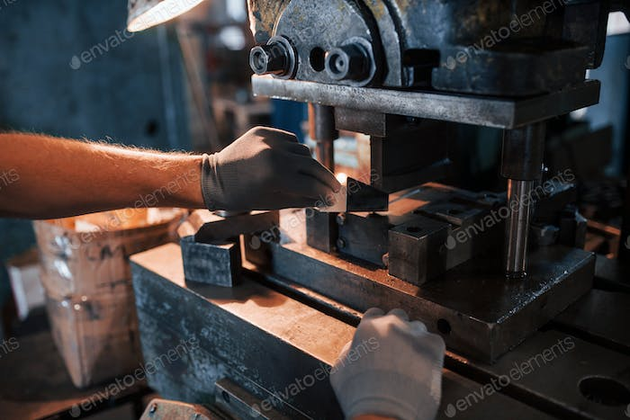 Photo of man's hands works with metal. Industrial conception