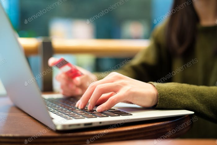 Woman using laptop computer for booking ticket
