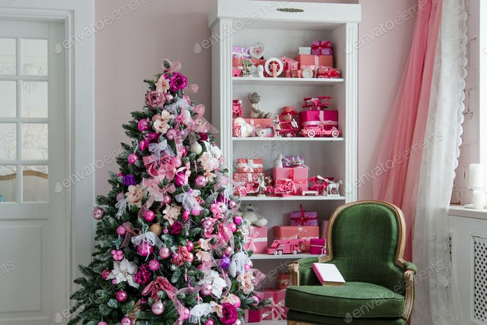 Beautiful holdiay decorated rooms with Christmas trees, shelf and pink blue gifts on it, green chair