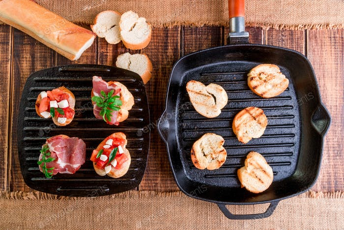 Toast on grill pan. Set of crostini
