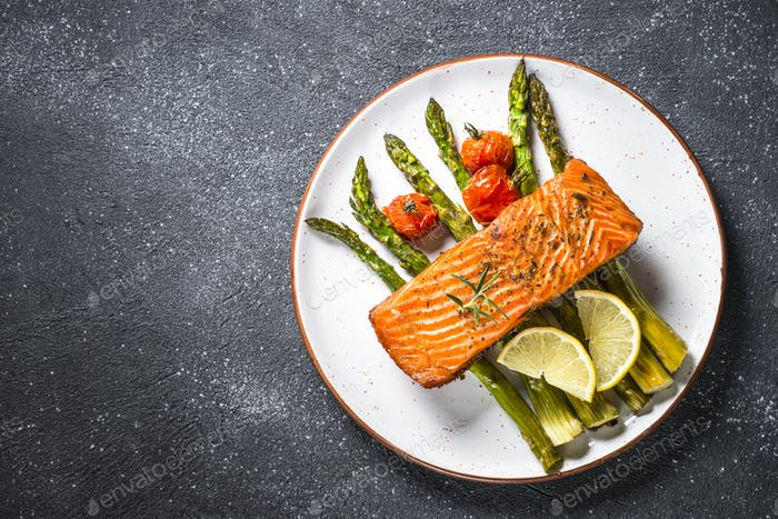 Baked salmon fish  with asparagus top view.