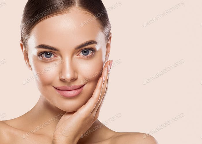 Woman beauty healthy clean fresh skin make up young model with hand touching face manicure nails