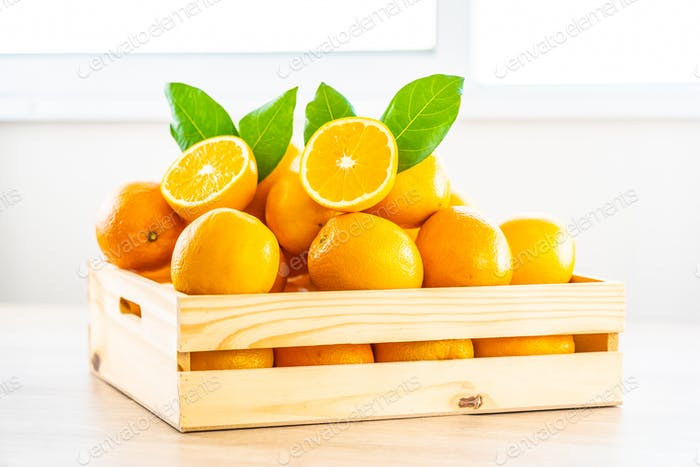 Fresh oranges fruit on table