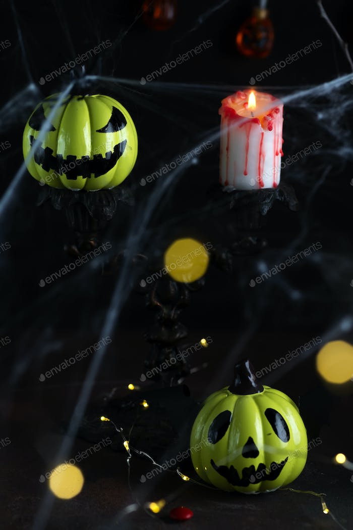 Halloween decorative background with scary laughing pumpkins.