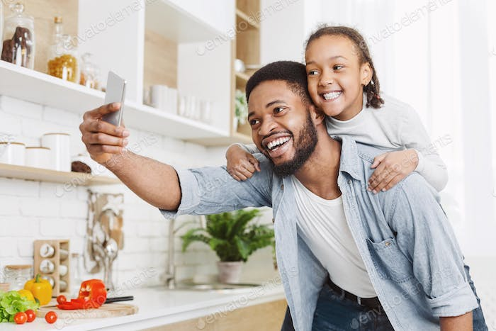 Daddy and daughter having fun at kitchen