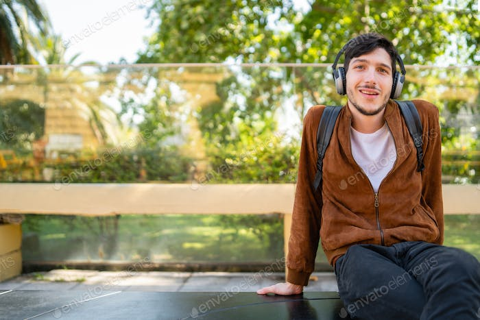 Man listening to music with earphones.