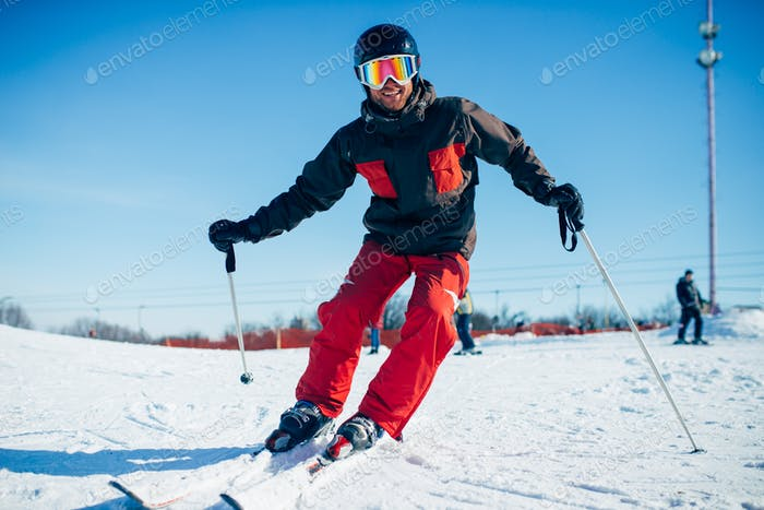 Skier riding from speed slope, front view