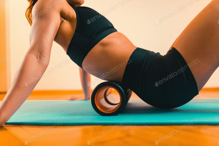 Massaging Lower Back with Foam Roller