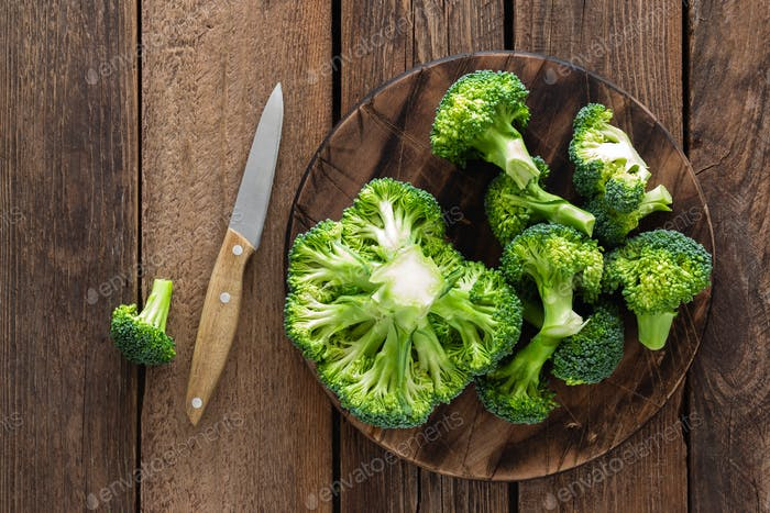 Fresh broccoli on wooden rustic table, top view