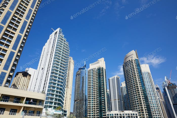 Dubai Marina skyscrapers, low angle view in a sunny day, clear blue sky in Dubai