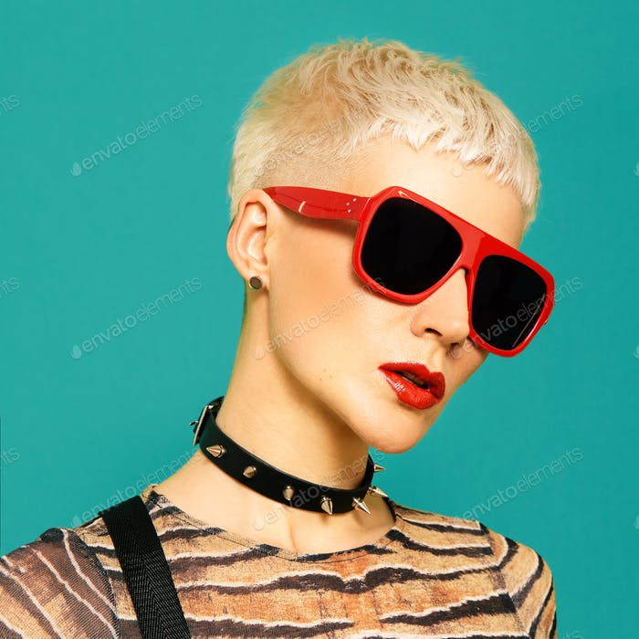 Stylish girl with short haircut in fashion accessories choker and sunglasses