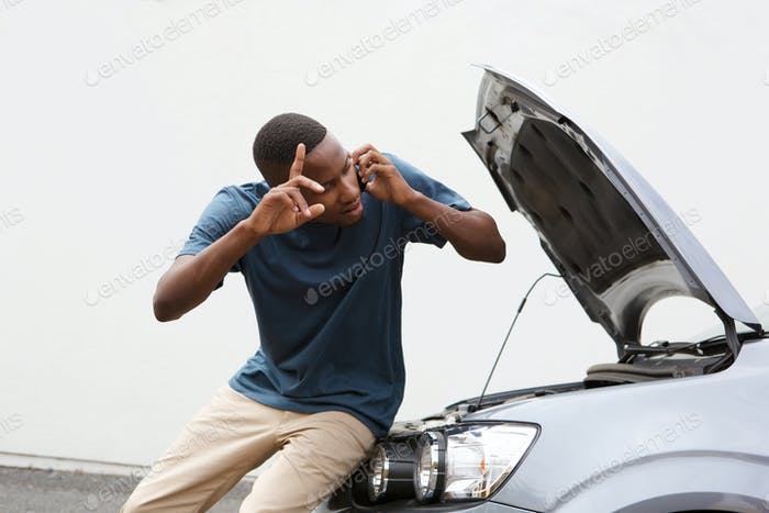 Young guy calls for help with by broken down car