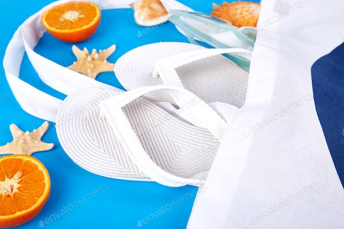 Summer beach bag with flip flops,