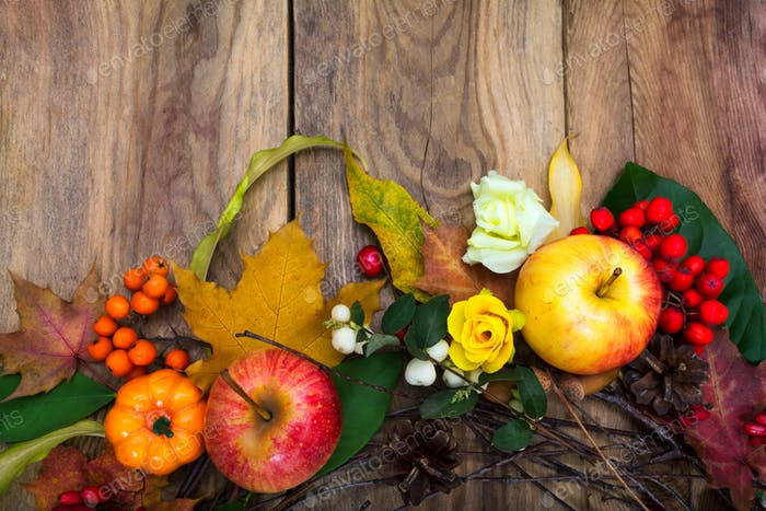 Fall decoration with pumpkin, apples, maple leaves, pine cones,