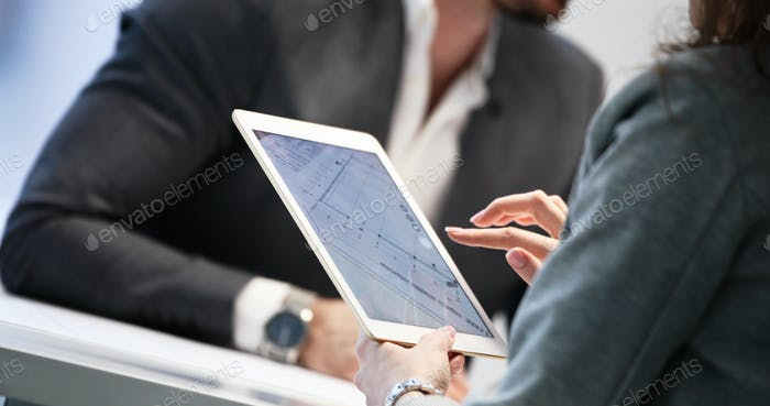 Close up picture of businessman using tablet