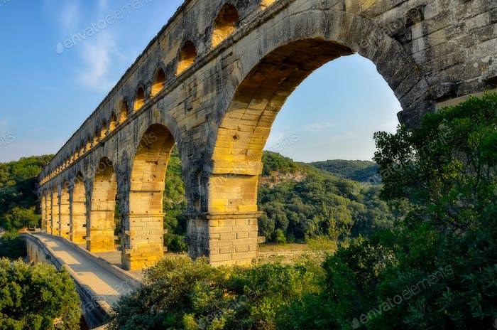 Landscape view of Pont du Gard bridge at sunset, France