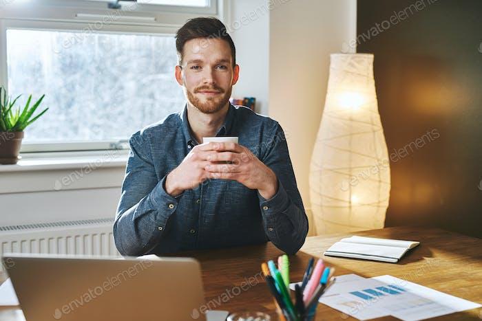 Entrepreneur sitting at his office
