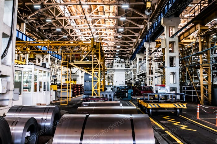 Rolls of iron plate on the modern tractor factory