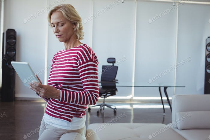 Entrepreneur using digital tablet at office