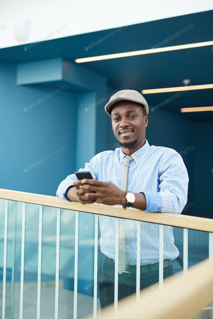 African man at office corridor