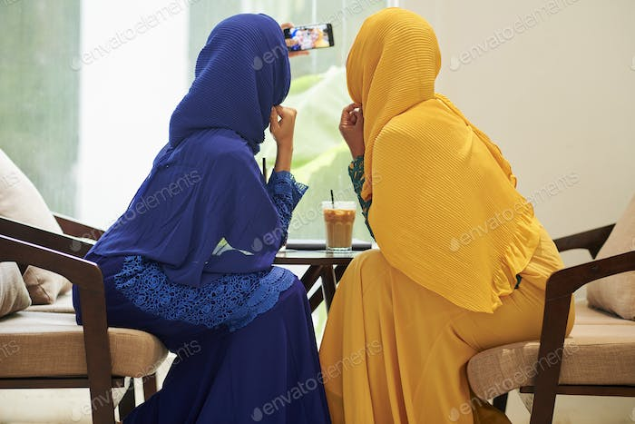 Muslim women posing for selfie