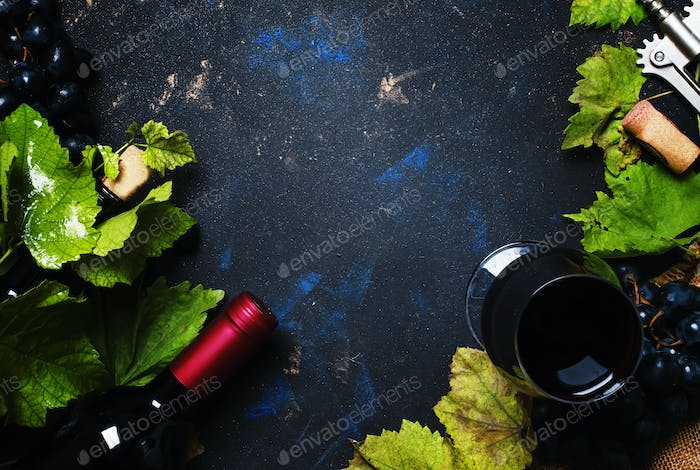 Red wine with grape, black background, top view